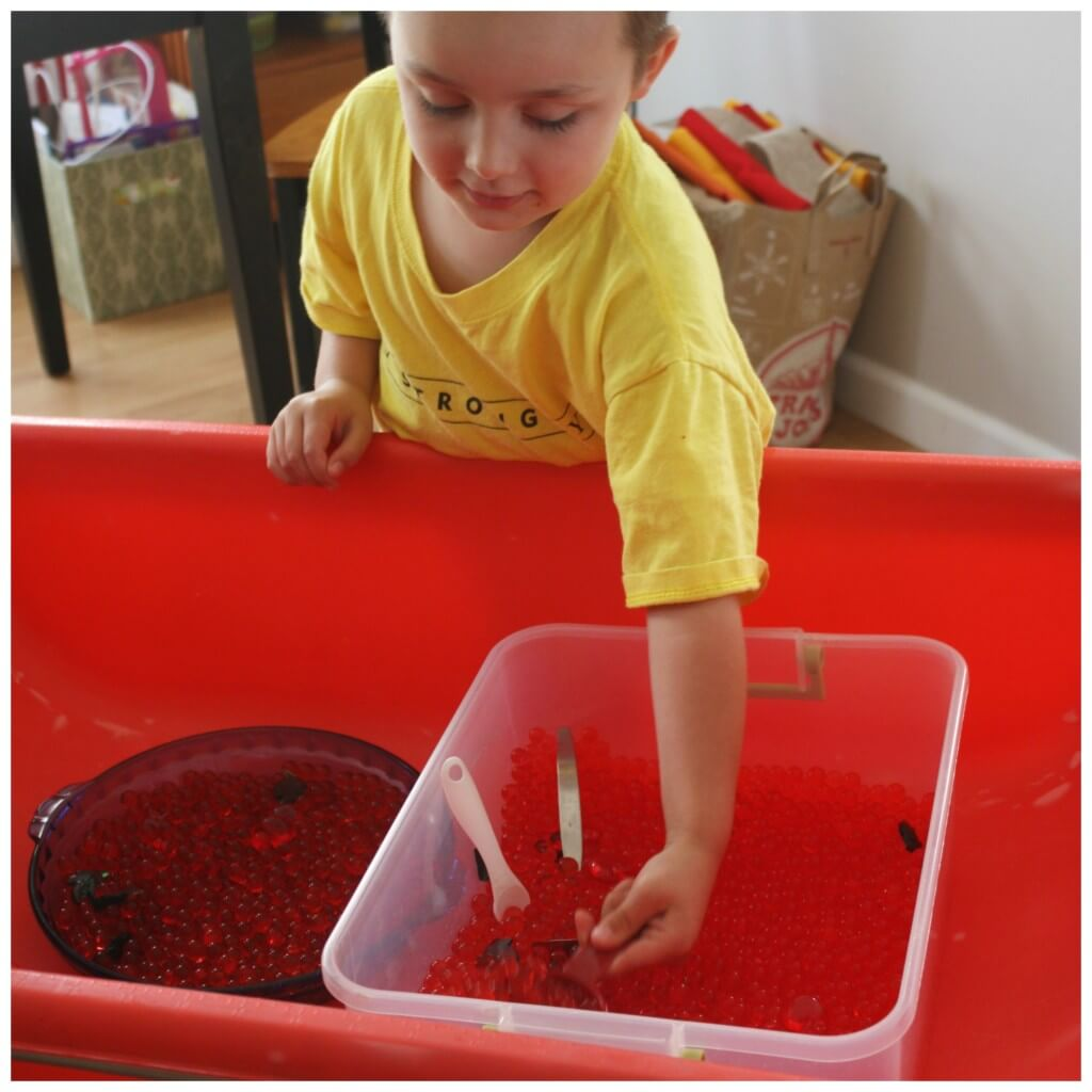apple water bead sensory bin of fall sensory play activities