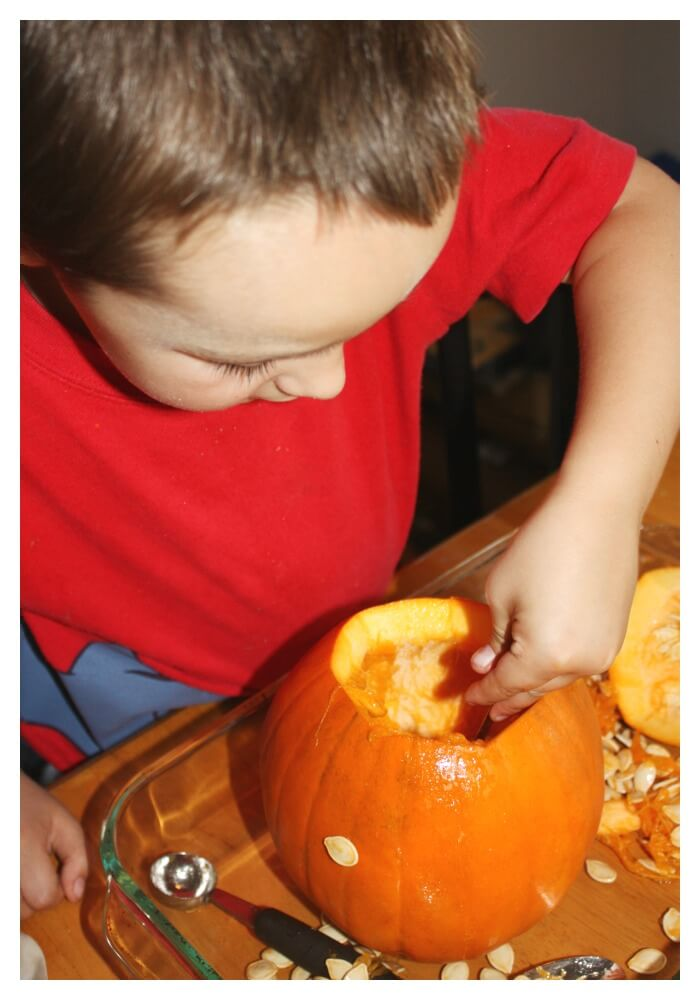 whole pumpkin sensory play cleaning out pumpkin insides
