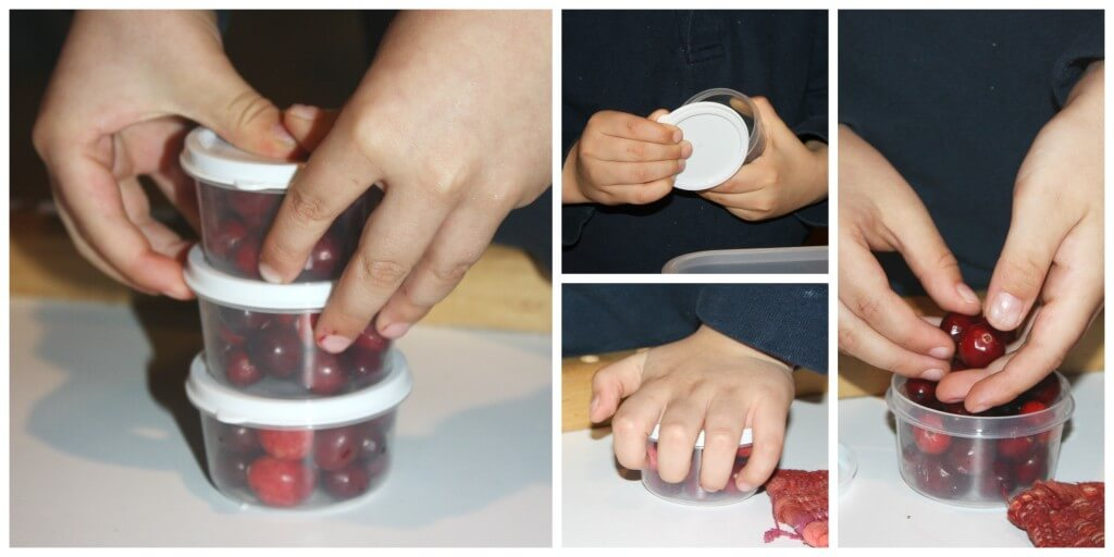 cranberry fine motor skills filling containers lids