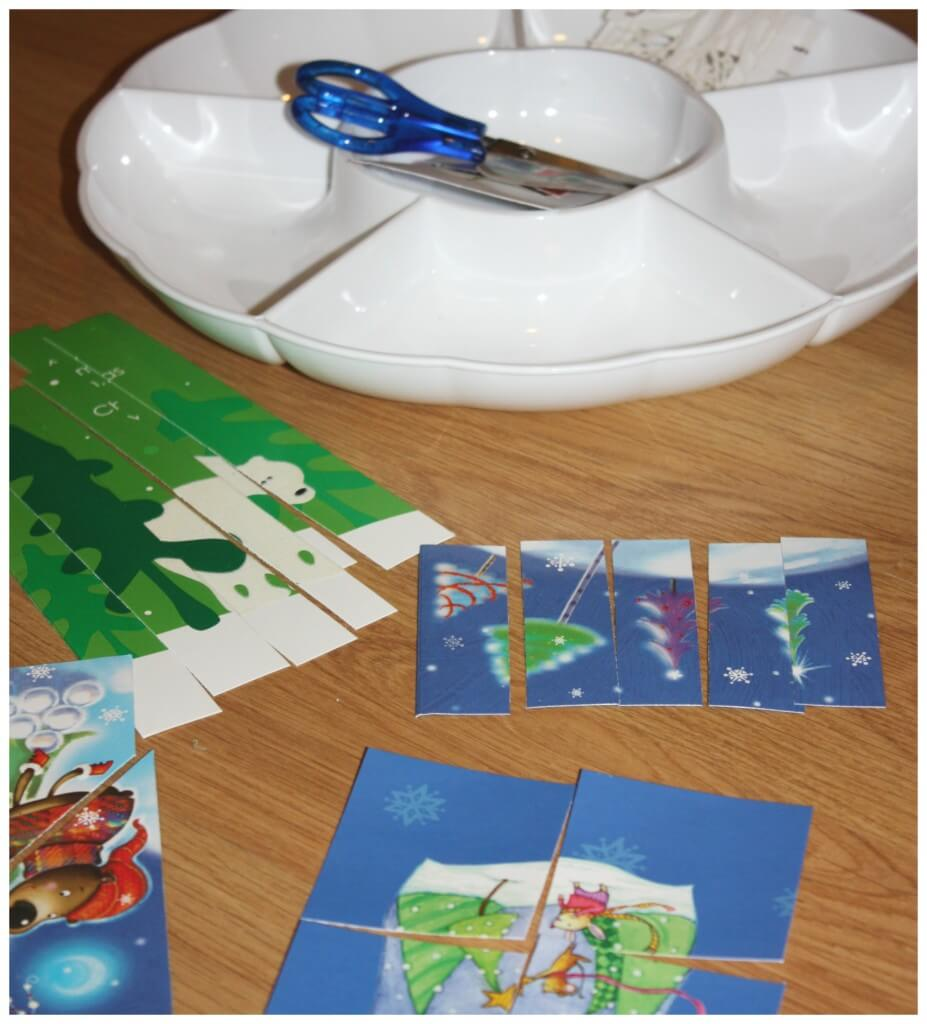 christmas fine motor skills card puzzle tray with completed puzzles