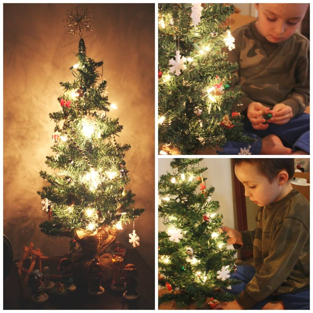 decorating tree by glow of lights