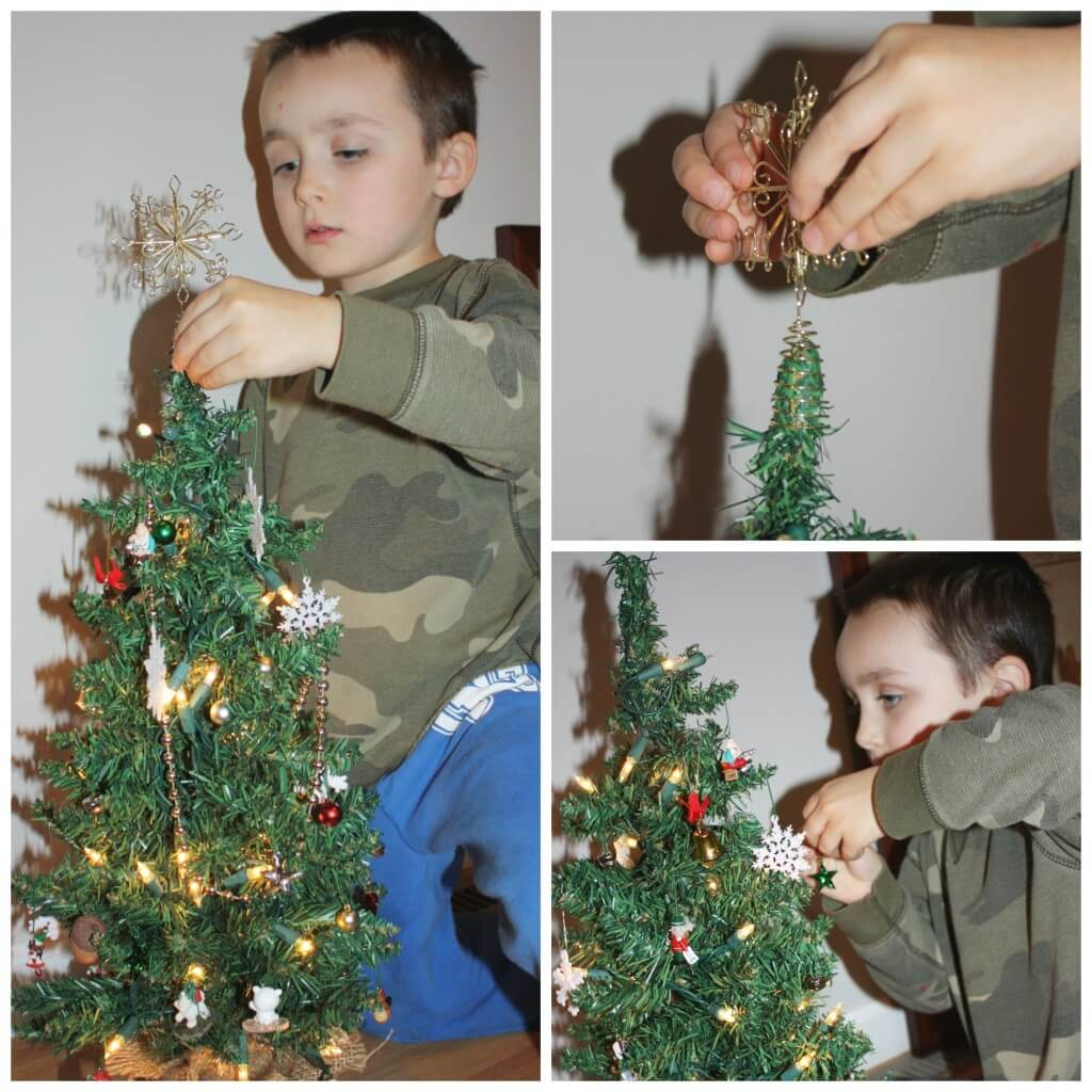 decorating tree with star