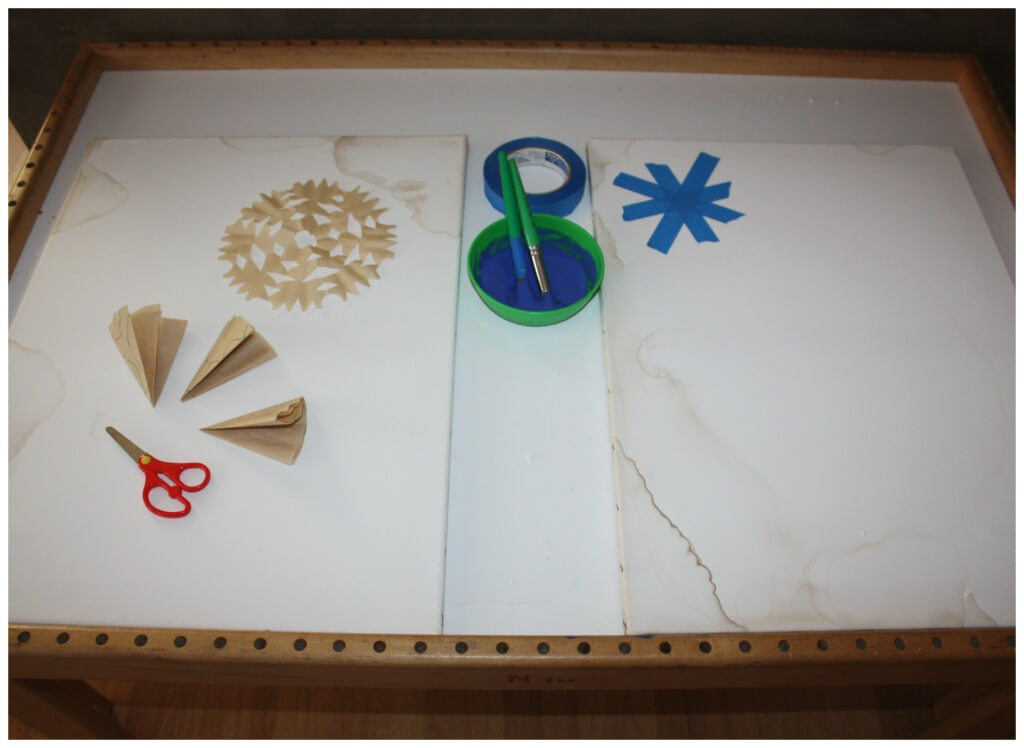 snowflake painting table set up