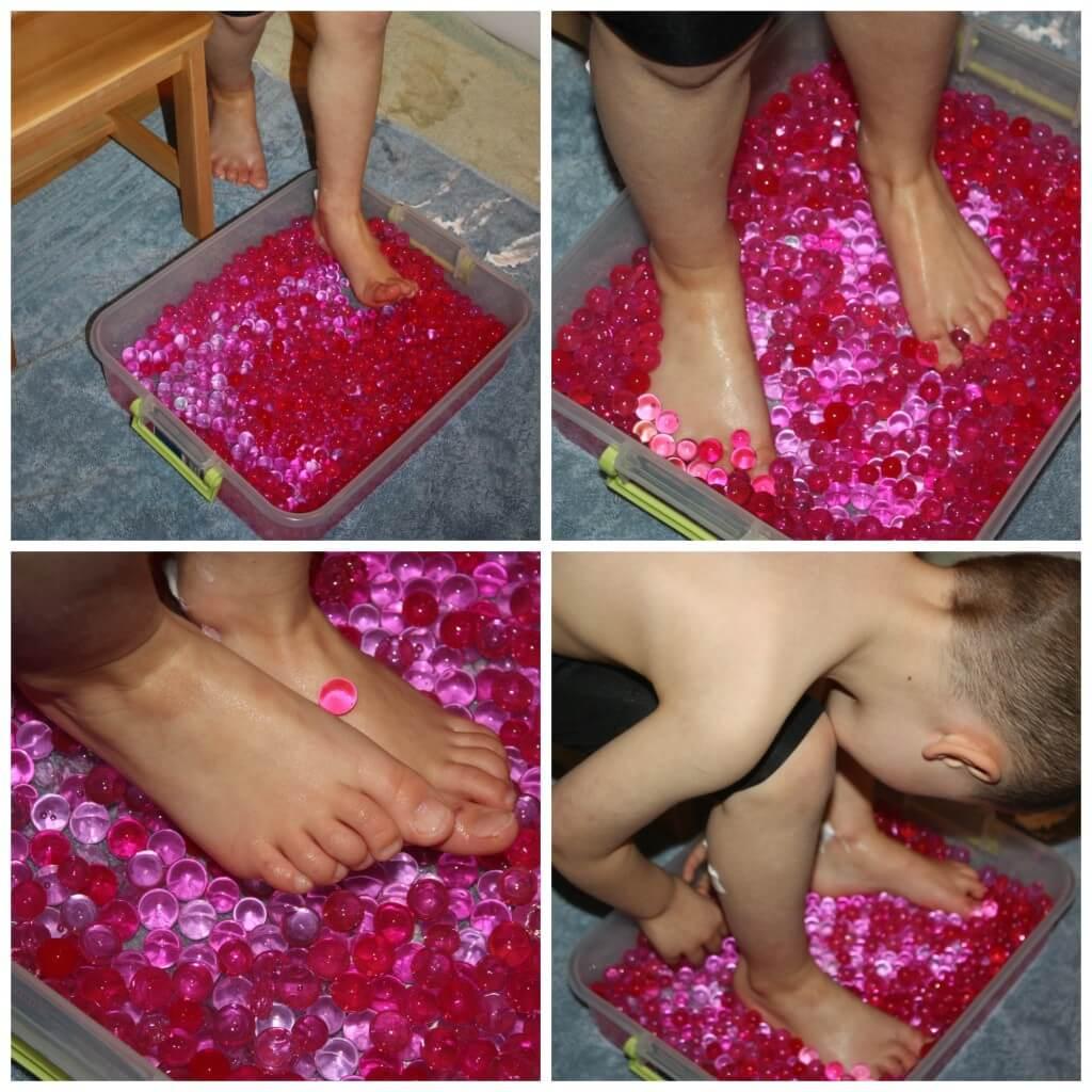feet sensory play water beads