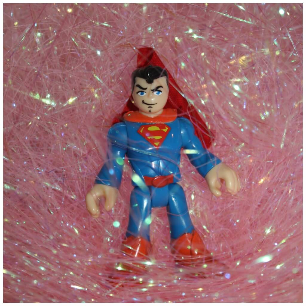 filling hearts sensory bin superman