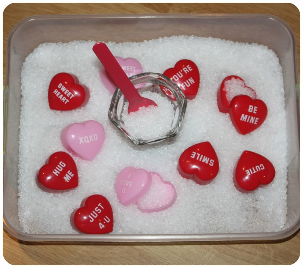 heart containers sensory bin set up