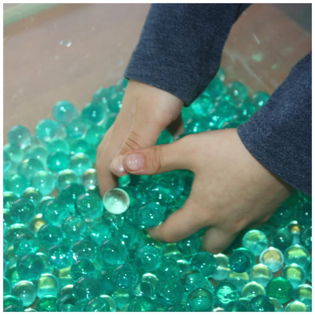 St Patricks Day Sensory Bin Water Beads Hands In Bin Play
