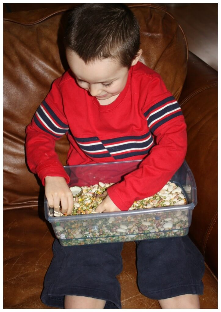 calming sensory bin sitting on couch playing