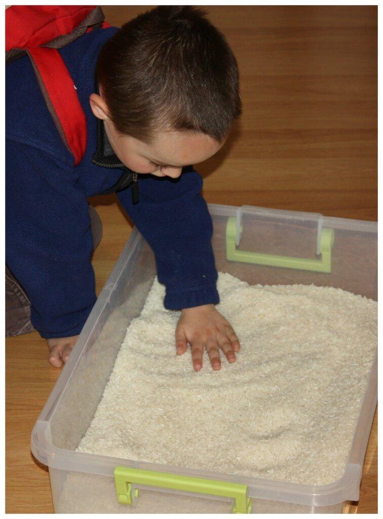 rice sensory bin challenge examining rice