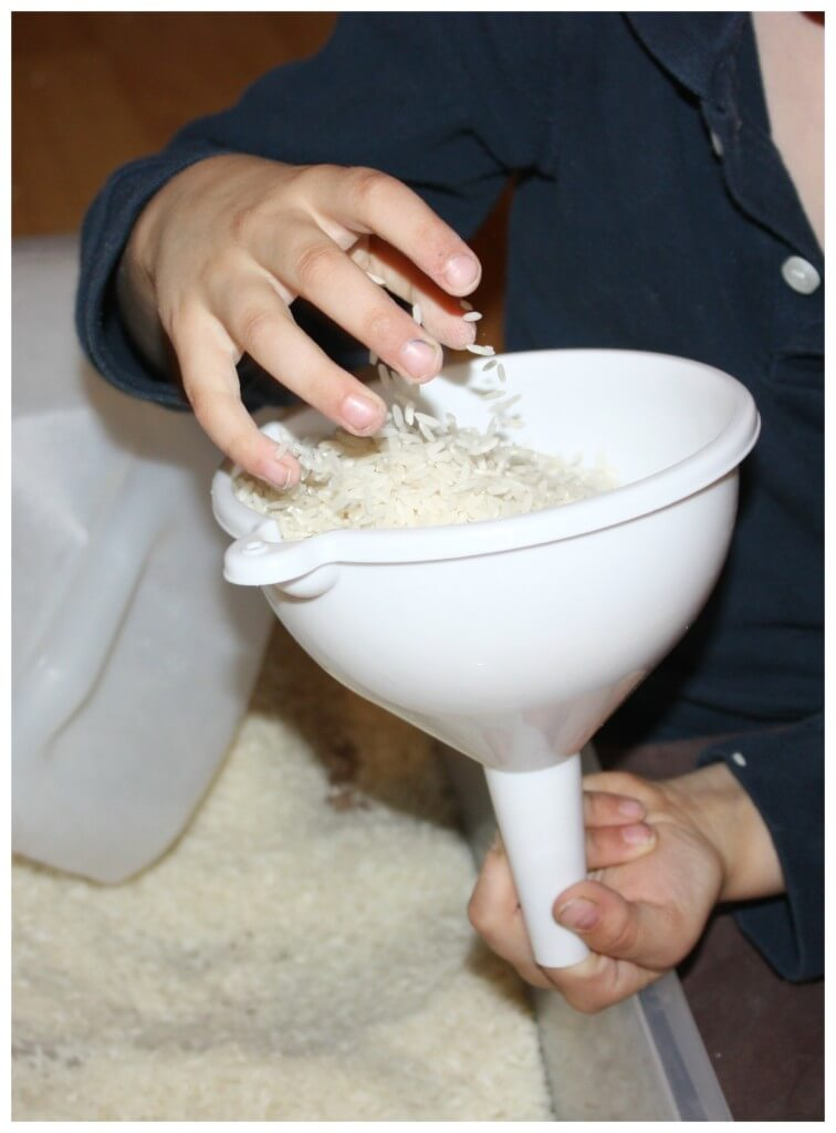 rice sensory bin challenge filling funnel