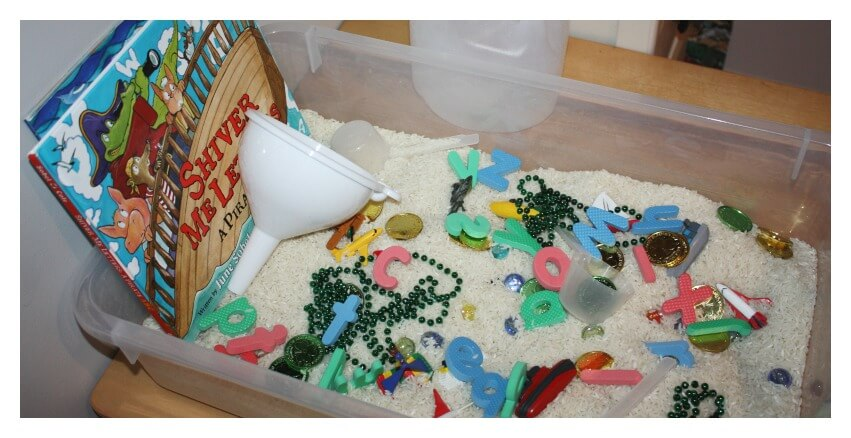 rice sensory bin challenge final bin with books