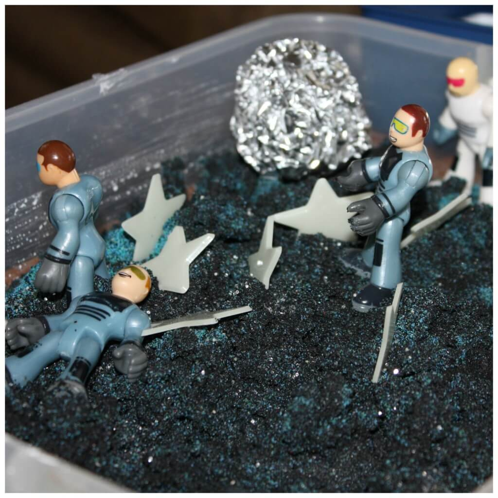 moon sand sensory bin with more men
