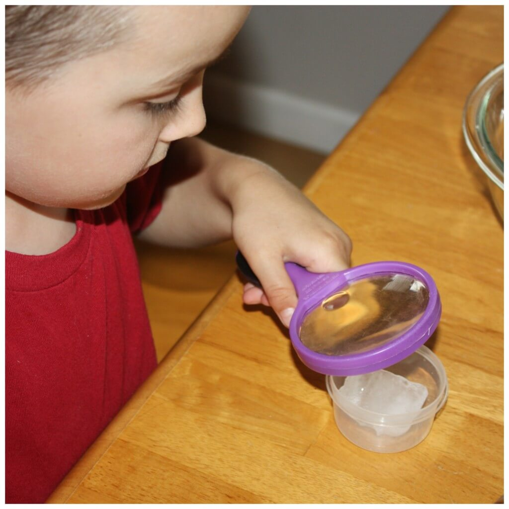 I is for Ice using magnifying glass to examine ice