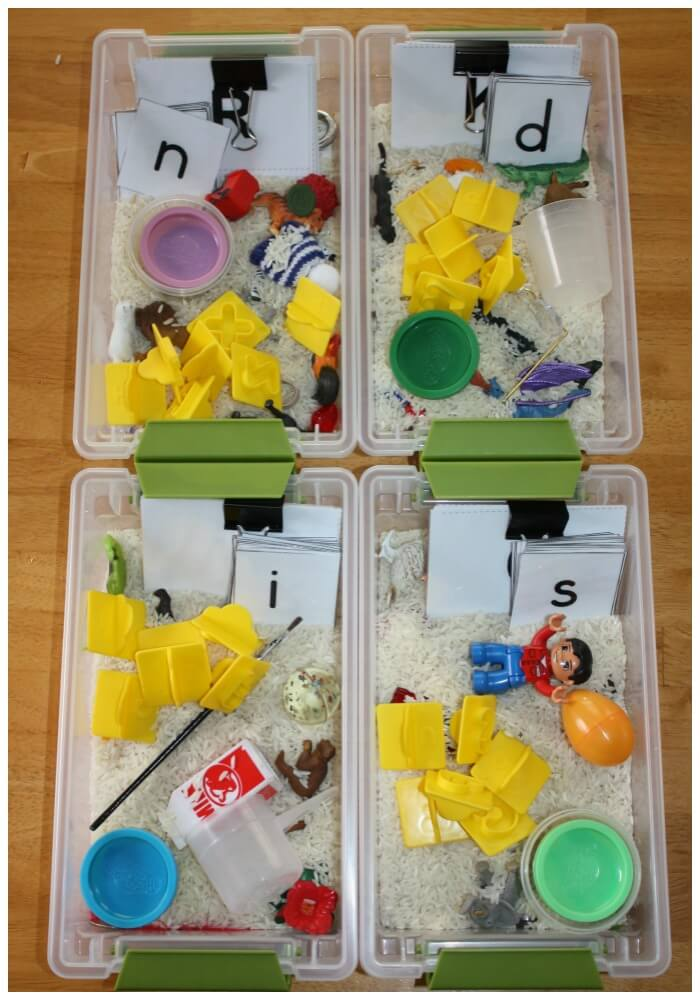 mini alphabet sensory bins close up of four boxes and contents
