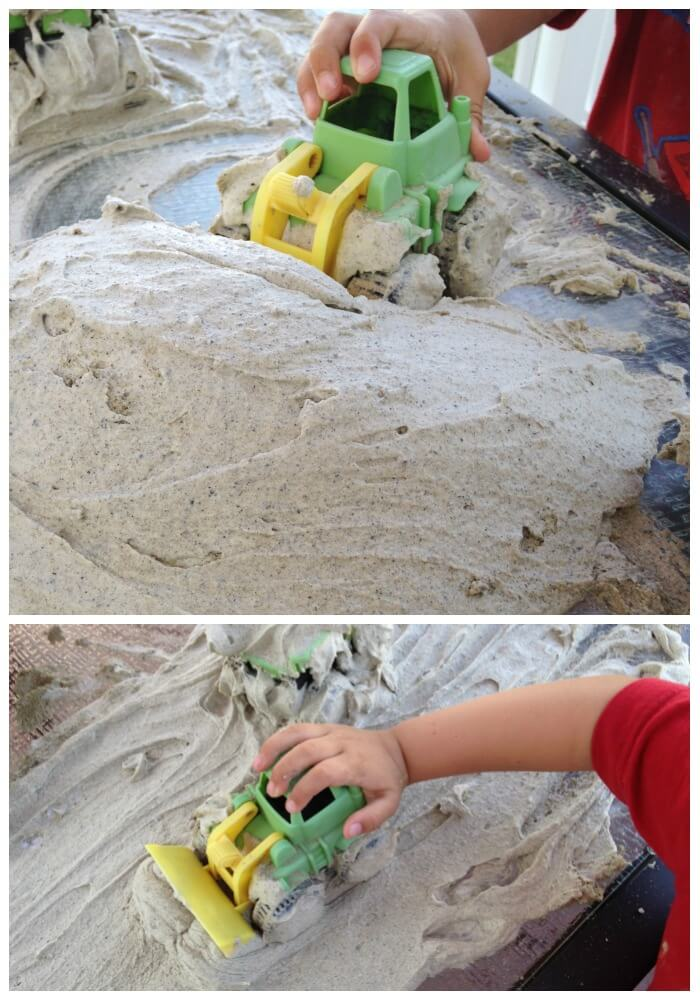 sand foam sensory play making piles and pushing them around with front loader