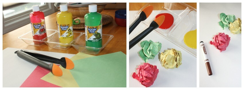 fall painting activity for kids set up with tongs