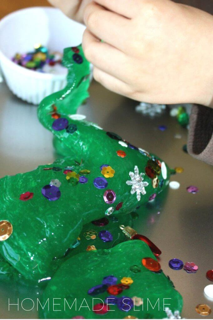 Playing with Christmas tree themed slime