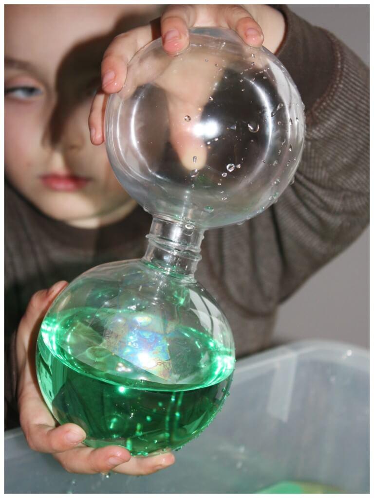 Christmas sensory water sensory bin with ornaments pouring