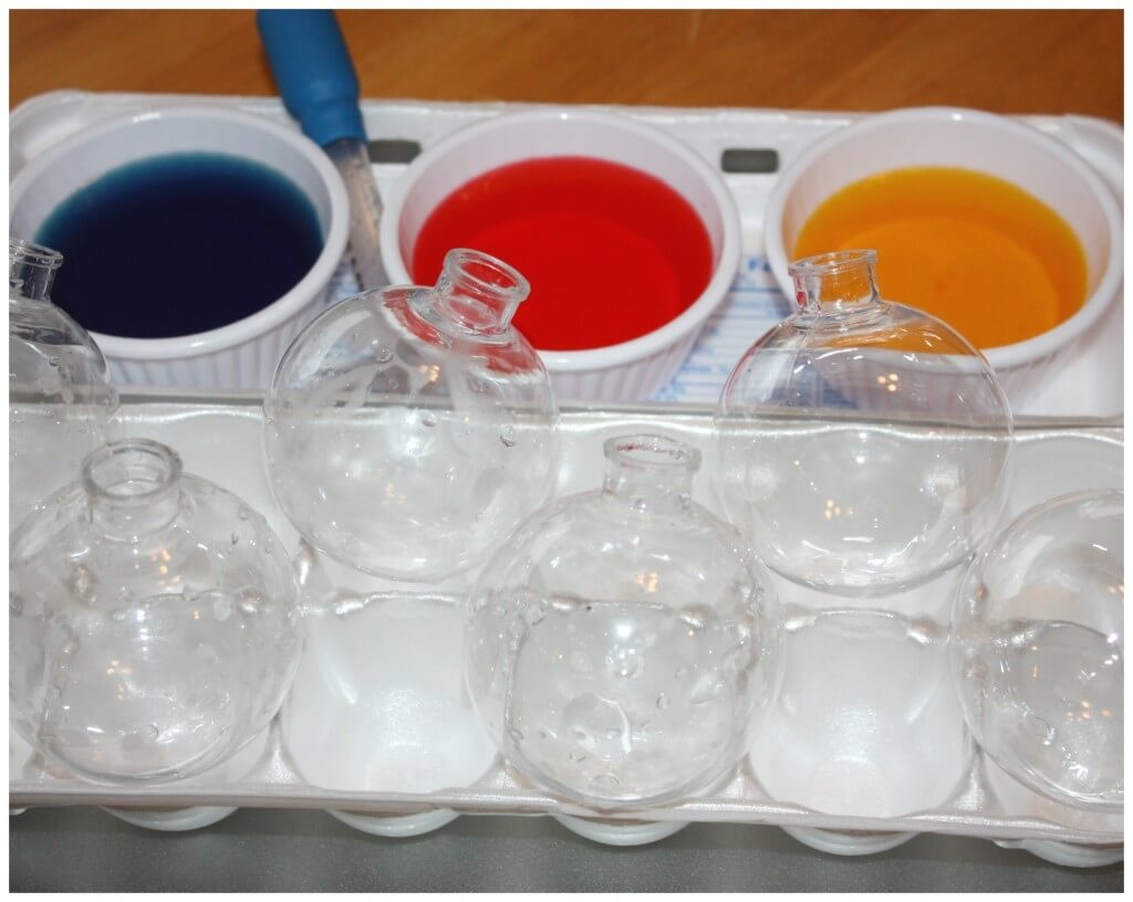color mixing christmas ornaments set up