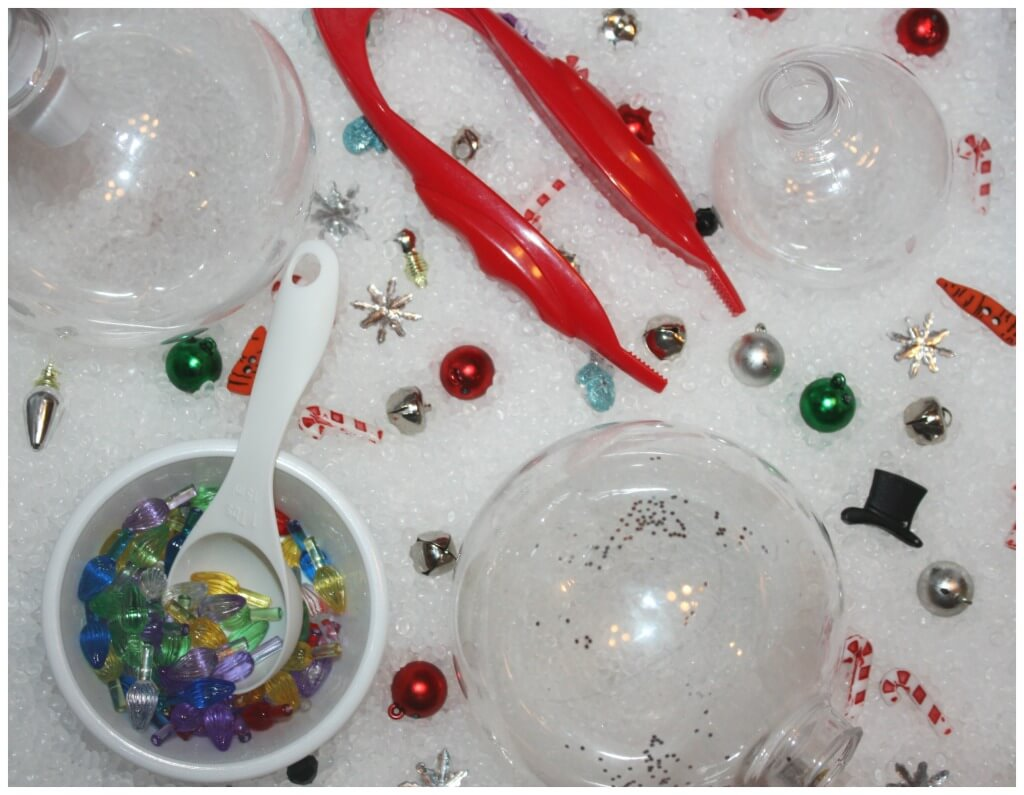 Christmas ornament sensory play activity set up with plastic ornaments