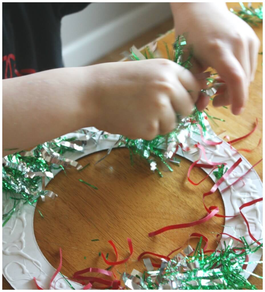 Christmas wreathe craft activity gluing garland cardboard wreathe