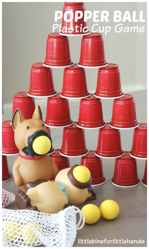 Popper Ball Game Set Up with Plastic Cup Pyramid Squeezing Activity