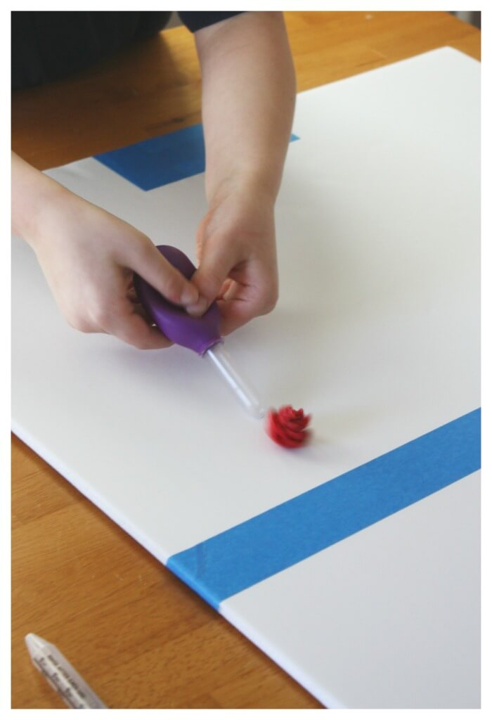 Table hockey squeezing eyedroppers to push paper into goal