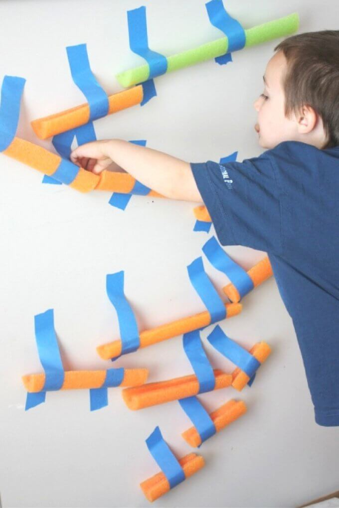 Building pool noodle marble run for STEM activity
