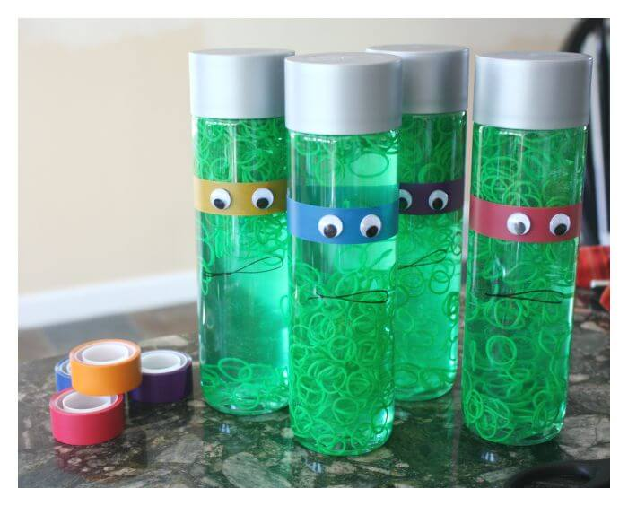 TMNT Sensory Bottles with Loom Bands and Colored Craft Tape
