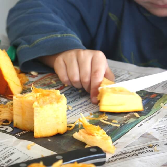 Pumpkin fine motor skills and science activity cutting pumpkin with knife