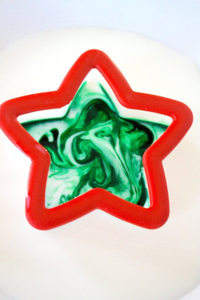 Christmas Magic Milk Science Using Cookie Cutters