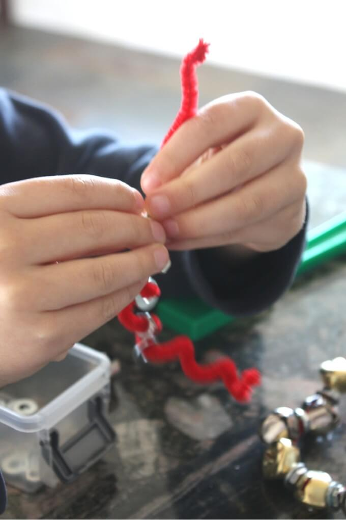 Making magnetic wreathes threading nuts and washers