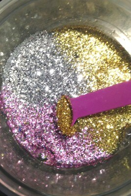 Party slime mixing glitter into glue