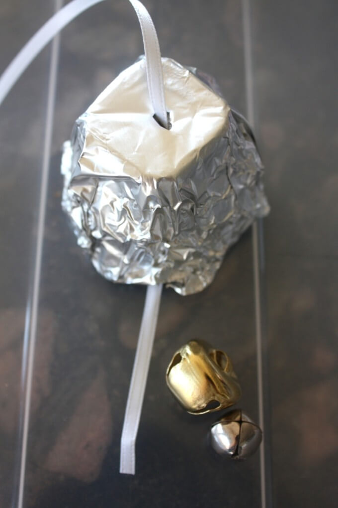 Tin foil bell ornament adding ribbon and bells