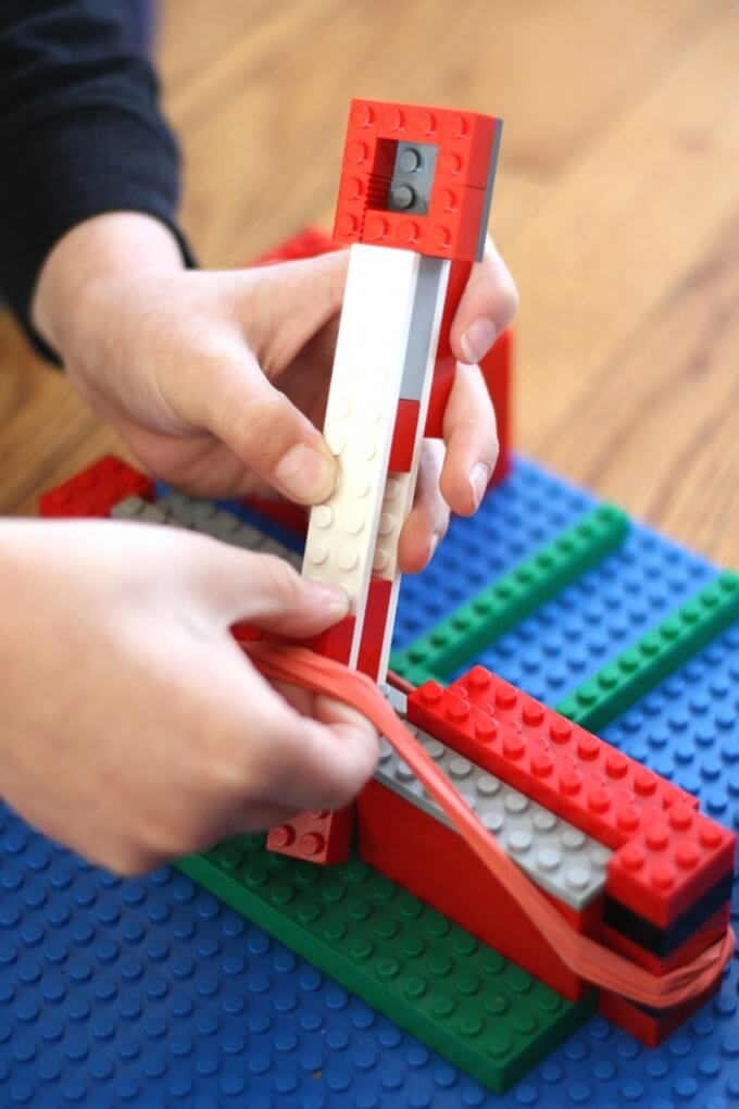 Adding a lever arm to our easy LEGO catapult with rubber bands for tension