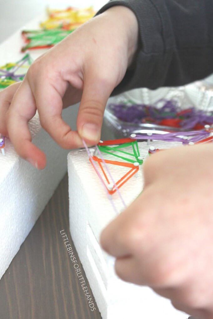 Adding loom bands to the star on our styrofoam shape geoboard math and art activity