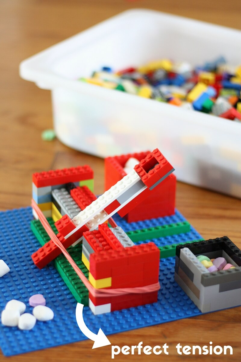 Build a kids Easy LEGO catapult and marshmallow launcher for a simple STEM activity