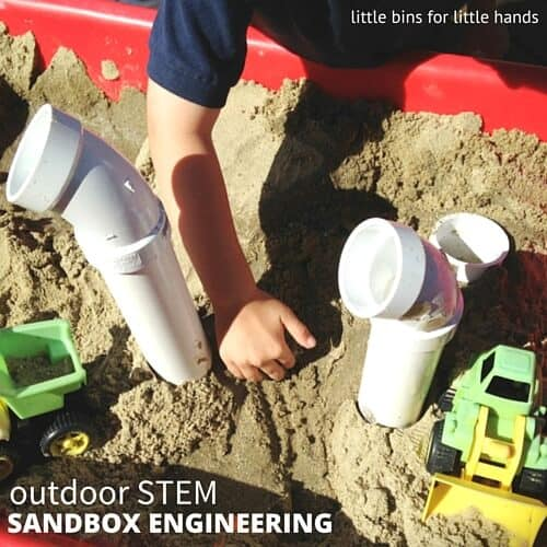 Engineering play in a sandbox with PVC pipes outdoor STEM activity-2
