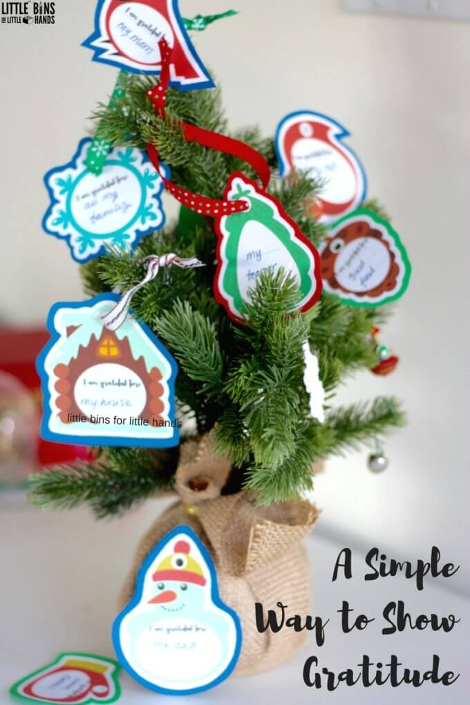 Gratitude ornaments on a small Christmas tree for kids