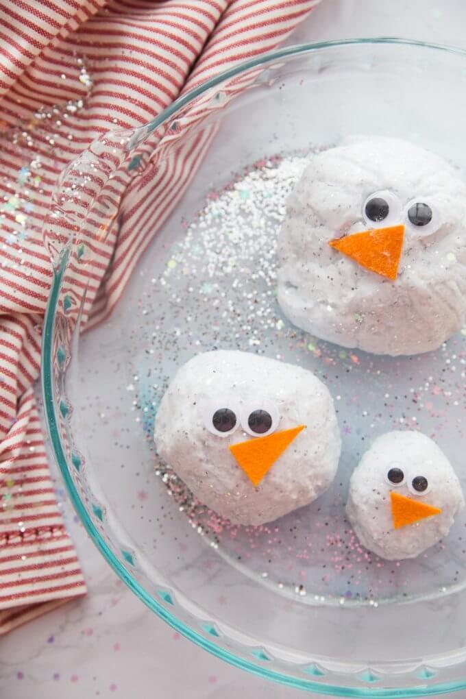 family of melting snowmen waiting for vinegar for quick winter chemistry
