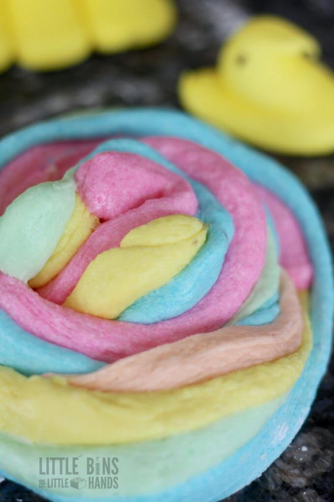 Peeps slime also looks like unicorn poop slime! Make peeps slime for Easter science for kids!