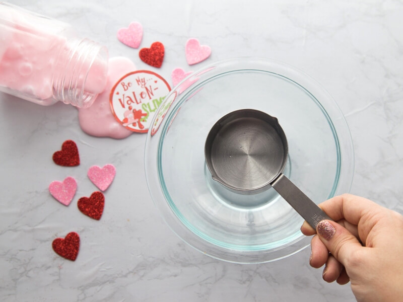 Mix glue and water together for Valentines Day slime