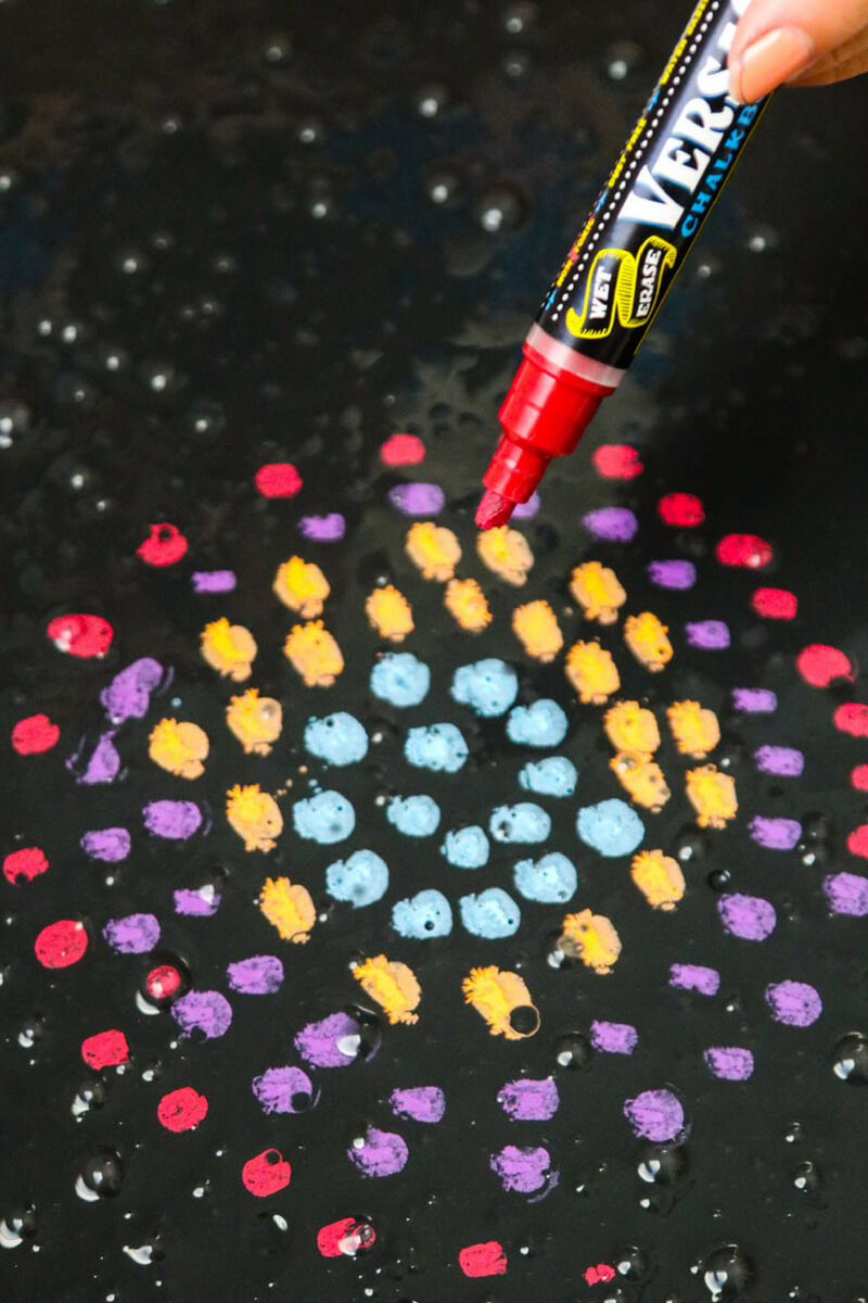 using chalk markers on chalkboard slime to make art