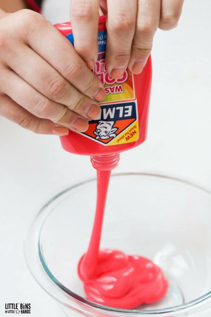 squeezing elmers color glue into bowl
