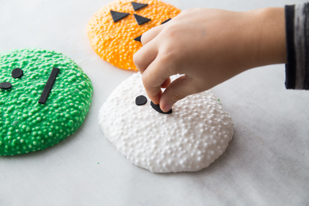 decorating ghost floam with black foam shapes
