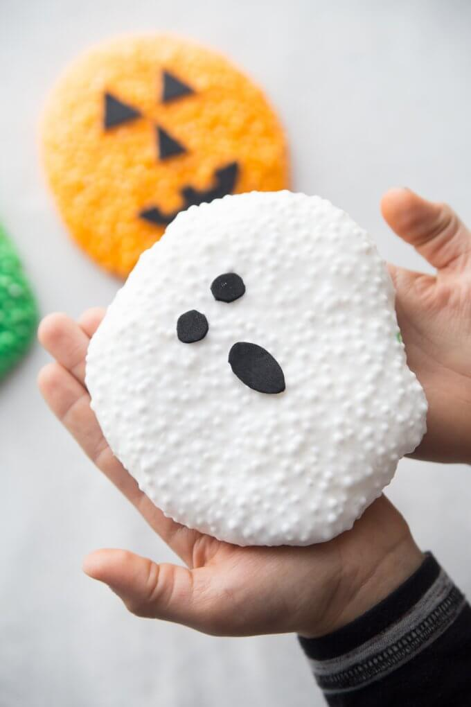 holding ghost halloween floam in hands