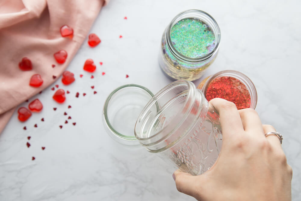 Add oil and water to jar for homemade lava lamp DIY science project