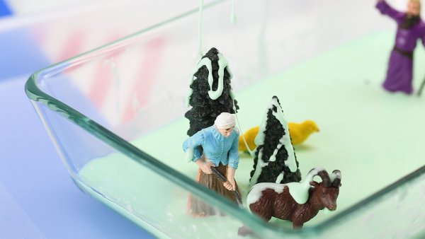 Plastic figures being drizzled with oobleck for Bartholomew and the Oobleck