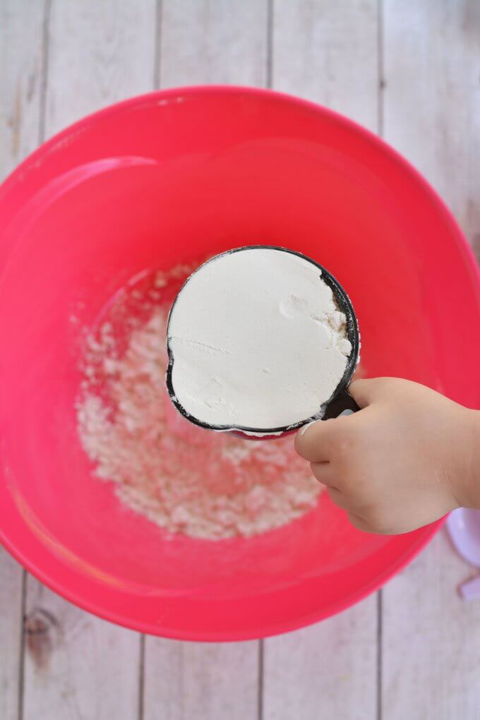 add flour to a large bowl