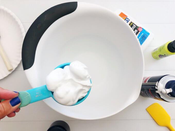 add shaving cream to a bowl